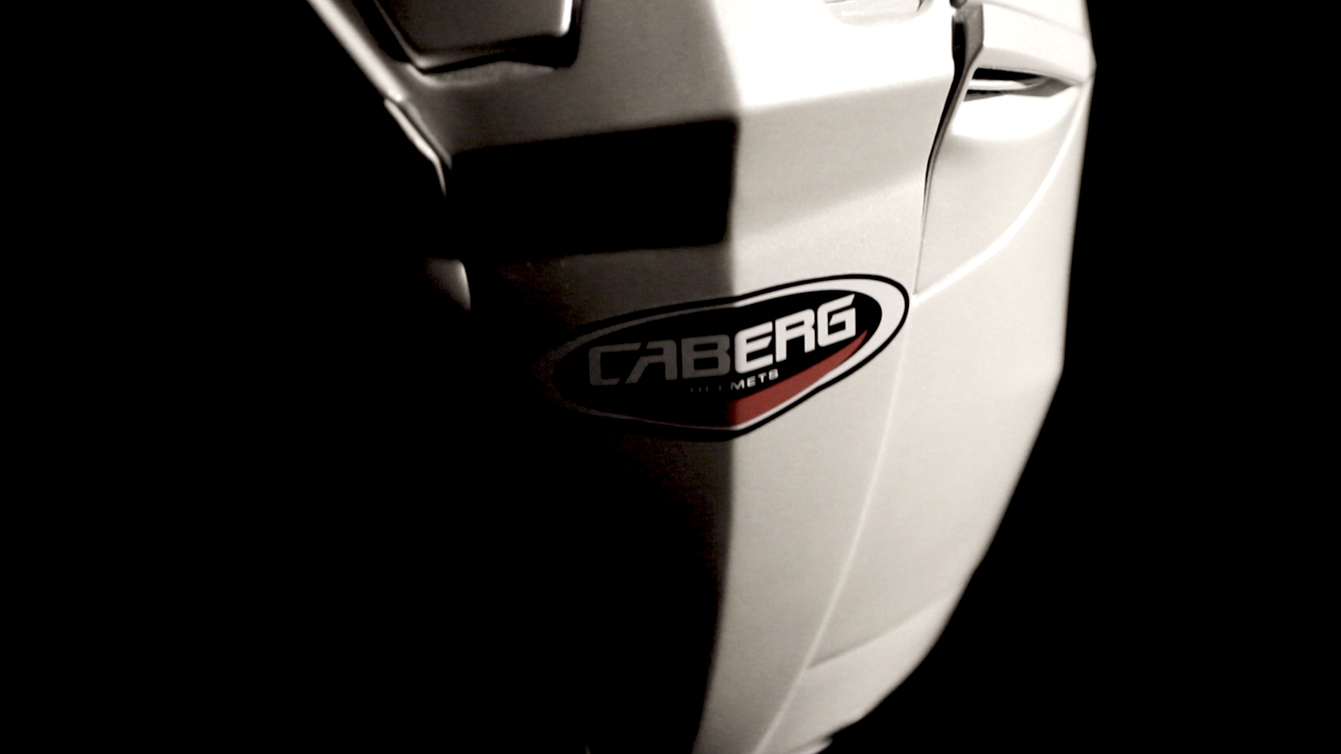 Back side of a white helmet with Caberg logo in the center